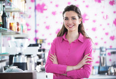 Beautiful smiling waitress in a cafe Stock Image