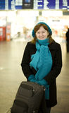Beautiful smiling woman in airport Royalty Free Stock Photo