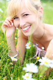 Beautiful smiling woman amongst spring flowers royalty free stock photography