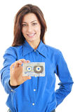Beautiful smiling woman with audio cassette in her hand stock photography
