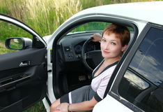 Beautiful smiling woman in auto Royalty Free Stock Photo