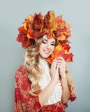 Beautiful smiling woman in autumn leaves crown portrait.  royalty free stock photos
