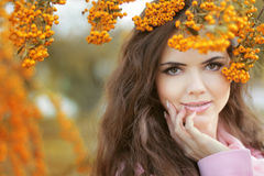 Beautiful smiling woman autumn portrait, colorful park. Outdoor. Stock Images