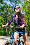 Beautiful smiling woman on a bicycle Royalty Free Stock Photo