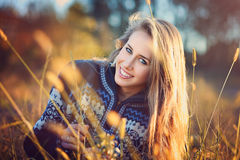 Beautiful smiling woman with blue eyes Stock Photo