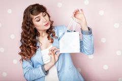 Woman in blue jacket holds gift box. stock image