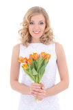 Beautiful smiling woman with bouquet of orange flowers isolated Royalty Free Stock Image