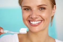 Beautiful Smiling Woman Brushing Healthy White Teeth With Brush Stock Image