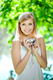 Beautiful smiling woman with a camera, outdoors Stock Image