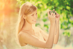 Beautiful smiling woman with a camera, outdoors Royalty Free Stock Photos