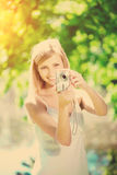 Beautiful smiling woman with a camera, outdoors Stock Images