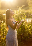 Beautiful smiling woman catching water drops at garden Stock Photography