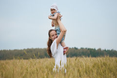 Beautiful smiling woman with child Royalty Free Stock Photography