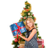 Beautiful  smiling woman and the Christmas tree. Royalty Free Stock Photography