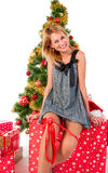 Beautiful  smiling woman and the Christmas tree. Royalty Free Stock Images