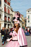 Beautiful smiling woman in colorful costume and mask on Piazza San Marco, Venice, Italy Royalty Free Stock Photos