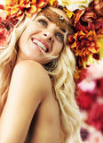 Beautiful smiling woman with colorful wreath stock image