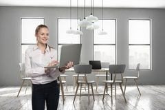 Beautiful smiling woman in conference room stock photo