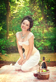 Beautiful smiling woman in corset and trousers Stock Photo