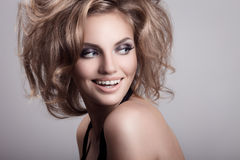 Beautiful smiling woman. Cosmetics and hairstyle. Royalty Free Stock Photos