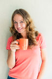 Beautiful and smiling woman with a cup Stock Photos