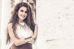 Beautiful smiling woman with curly hair. Fashion look royalty free stock photos