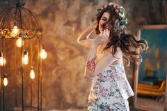 Beautiful smiling woman dancing and posing. Happy girl having fun stock photography