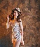 Beautiful smiling woman dancing and posing. Happy girl having fun stock image