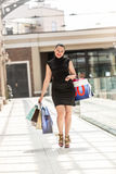 Beautiful smiling woman doing shopping at mall Royalty Free Stock Image