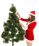 Beautiful smiling woman dreesed fir tree. Isolated on white Royalty Free Stock Image