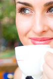 Beautiful smiling woman drinking coffee Stock Photos