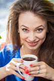 Beautiful smiling woman drinking a cup of coffee Royalty Free Stock Image