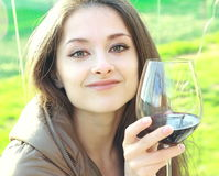 Beautiful smiling woman drinking wine Royalty Free Stock Photography