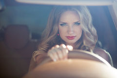 Beautiful Smiling woman driving car, attractive girl sitting in Stock Photos