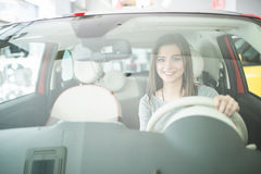Beautiful Smiling woman driving car, attractive girl sitting in automobile. Royalty Free Stock Image