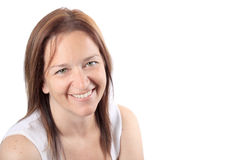 Beautiful smiling woman in early forties. Pretty brunette adult woman in her early forties smiling happily on a white background Royalty Free Stock Photos