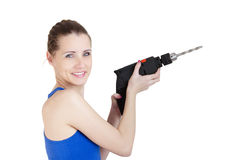 Beautiful smiling woman with electric drill in hand Stock Photography