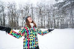 Beautiful smiling woman enjoy at winter day while snow falling Royalty Free Stock Images