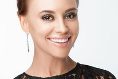 Beautiful smiling woman with evening make-up. Jewelry and Beauty. Fashion photo Royalty Free Stock Image