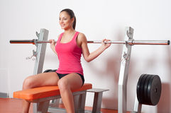 Beautiful smiling woman exercising with weights Stock Photo