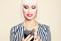 Beautiful Smiling Woman Fashion Model Looking at Mobile Phone Stock Photos