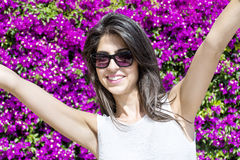 Beautiful smiling woman  in front of bougainvilleas flowers Stock Image