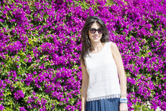 Beautiful smiling woman  in front of bougainvilleas flowers Royalty Free Stock Photography