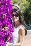 Beautiful smiling woman  in front of bougainvilleas flowers Royalty Free Stock Image