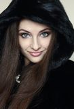 Beautiful smiling woman in fur hood coat Royalty Free Stock Photo