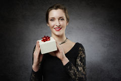Beautiful smiling woman with gift box Stock Photos