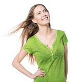 Beautiful smiling woman in green t-shirt looking up isolated on white Royalty Free Stock Photo
