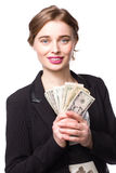 Beautiful smiling woman with a handful of dollars Royalty Free Stock Photography