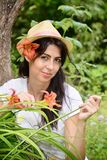 Beautiful smiling woman with hat  in a spring garden Royalty Free Stock Photography