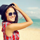 Beautiful smiling woman in hat and sunglasses close up Stock Photo